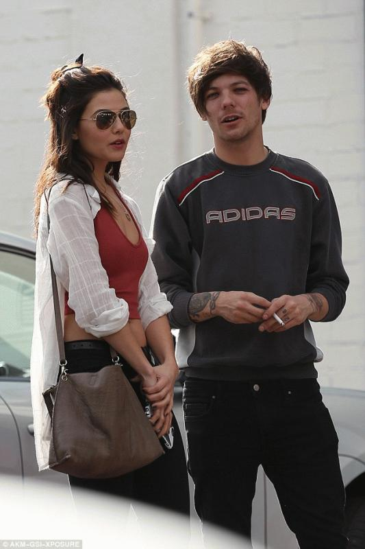 Louis Tomlinson with Danielle Campbell at a parking lot after they went grocery shopping in Los Angeles.