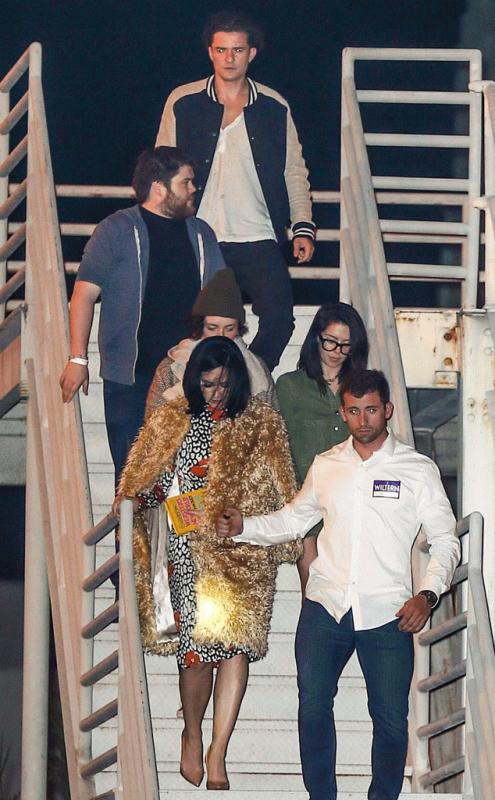 Katy Perry and Orlando Bloom leaving the concert of Adele with a group of friends.
