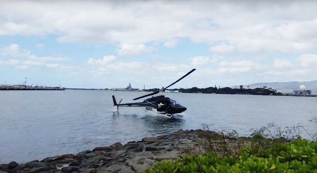 A tour helicopter crashed in waters near the USS Arizona Memorial in Hawaii on Thursday injuring five people, the U.S. Coast Guard reported.