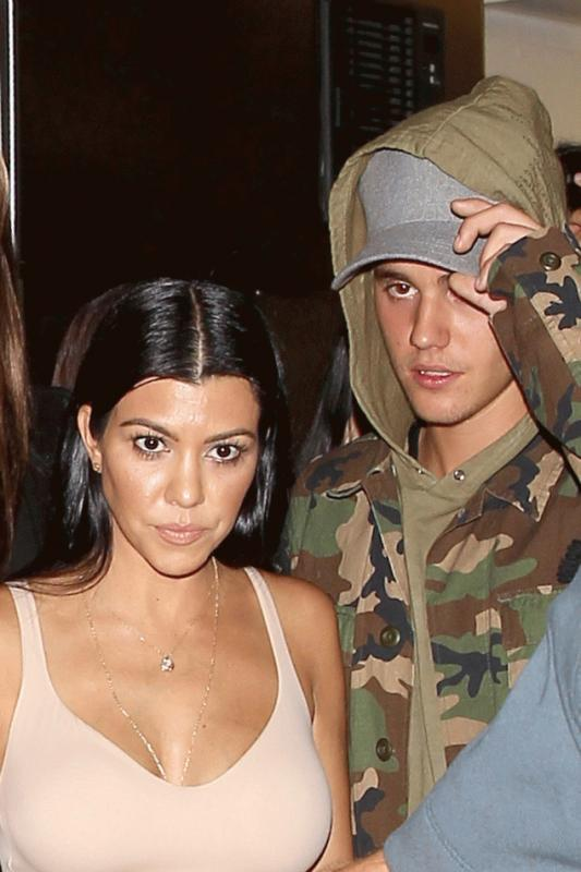 Kourtney Kardashian and Justin Bieber photographed last year after they were spotted emerging from a night club in Hollywood.