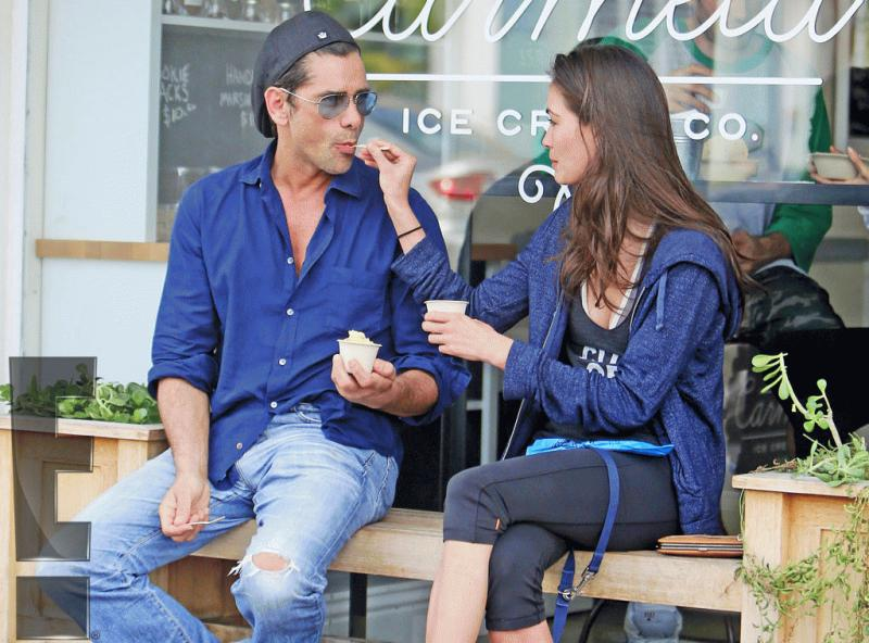 John Stamos eating ice cream with a mystery woman on Tuesday.