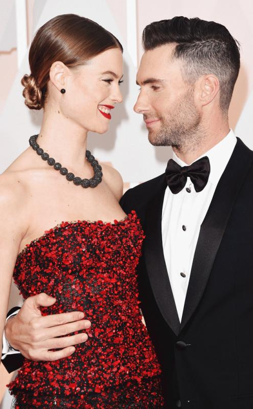 Adam Levine and Behati Prinsloo at a red carpet event.