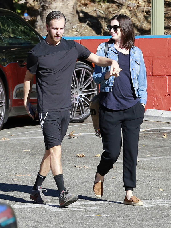 Anne Hathaway and Adam Shulman photographed earlier this year when rumors started that the two are expecting.