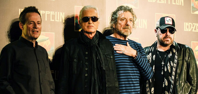 A photo showing some of the members of Led Zeppelin.