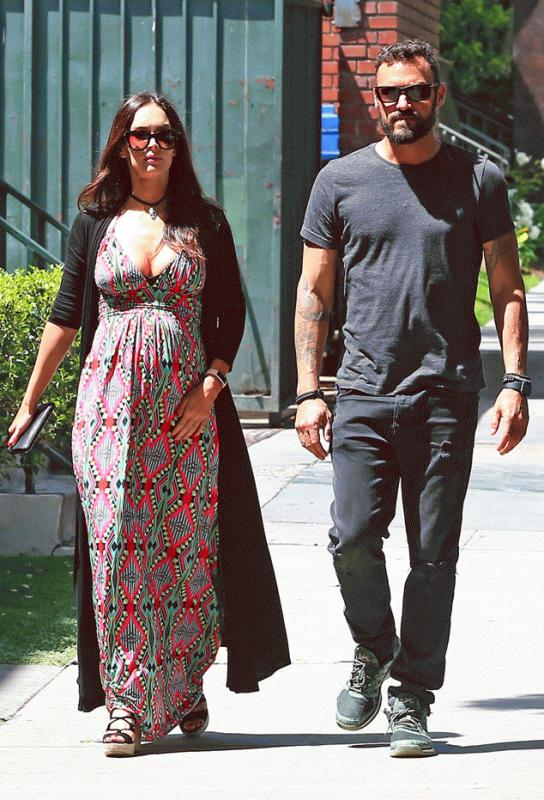 Megan Fox with Brian Austin Green in their latest outing after it was reported that she is pregnant with their third child.