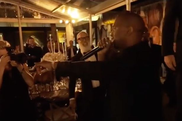 A screenshot showing Kanye West interrupting the speech of DuJour magazine founder Jason Binn as they attended David Grutman and Isabela Rangel's wedding over the weekend.