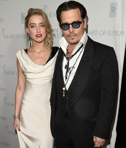 Amber Heard and Johnny Depp in an undated photo during happier times.