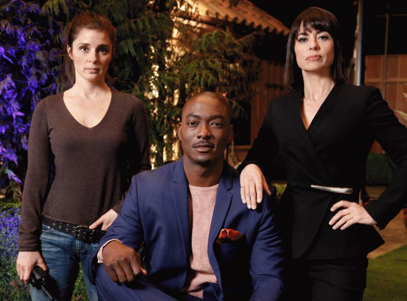 "A promotional photo for ""UnReal"" showing Quinn and Rachel with the new bachelor for their show ""Everlasting."""