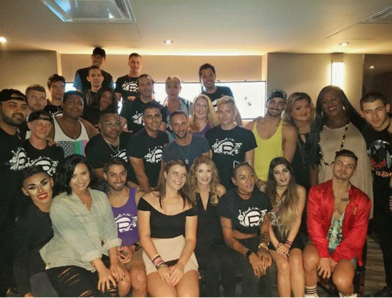 A photo showing Demi Lovato and Nick Jonas with the staff of Pulse night club.