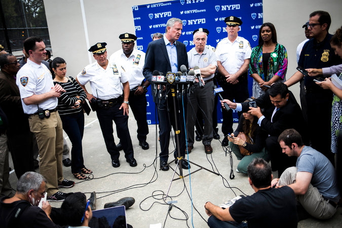 Mayor Bill de Blasio at a news conference on Monday after the shootings during J