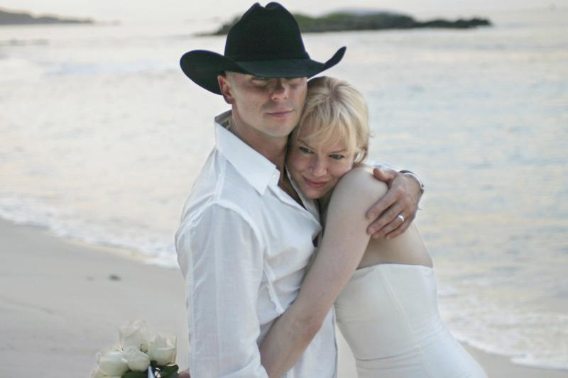 Renee Zellweger and her former husband Kenny Chesney photographed during their beach wedding.