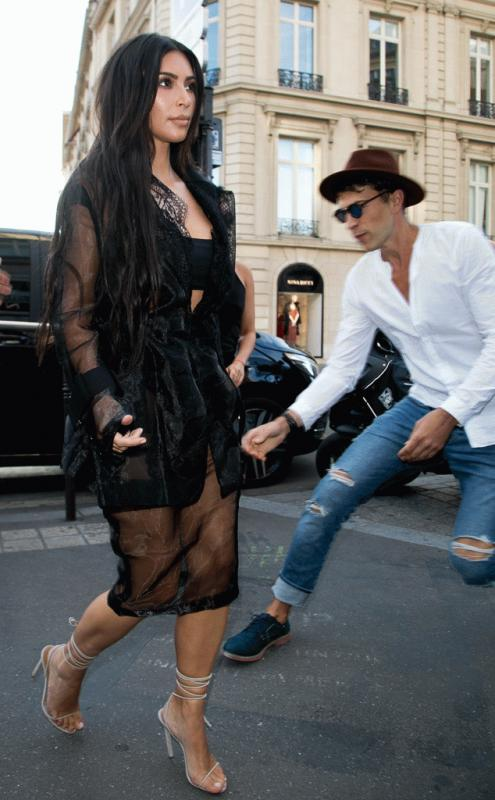 Kim Kardashian passes by while Vitalii Sediuk tries to attack her.