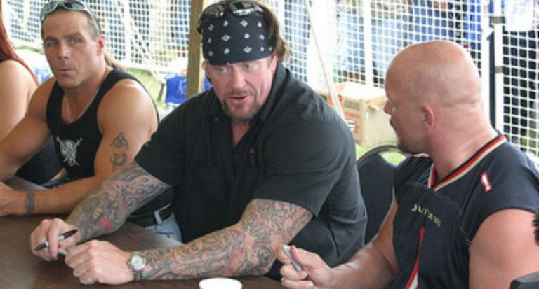 Shawn Michaels (L), The Undertaker (C) and Stone Cold Steve Austin (R) in an undated photo.