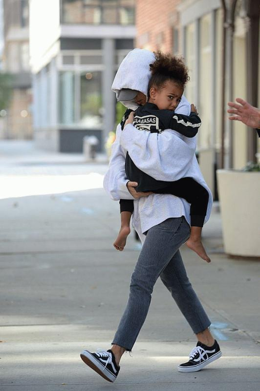 Kim Kardashian with North West photographed while arriving in Los Angeles from NYC.