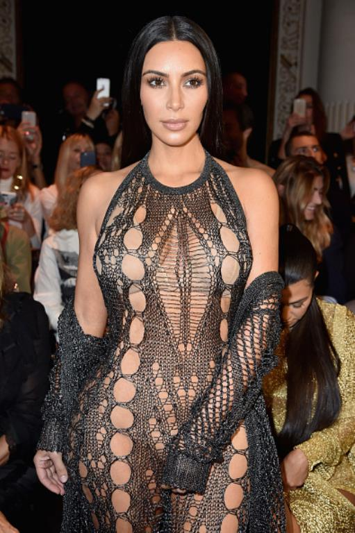 Kim Kardashian photographed at this year's Paris Fashion Week days before she was robbed at her hotel room.
