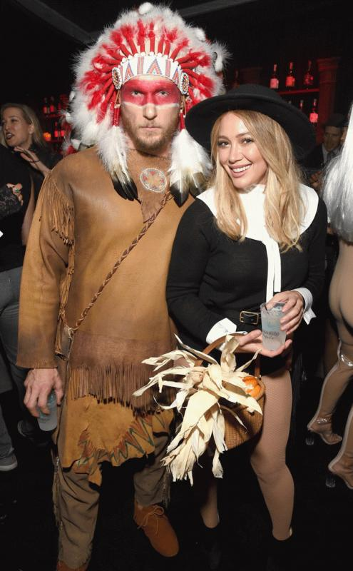 Hillary Duff and Jason Walsh photographed together wearing their costumes at a Halloween party.