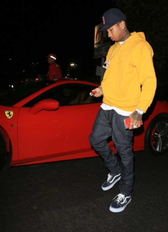 Tyga and his Ferrari in an undated photo.