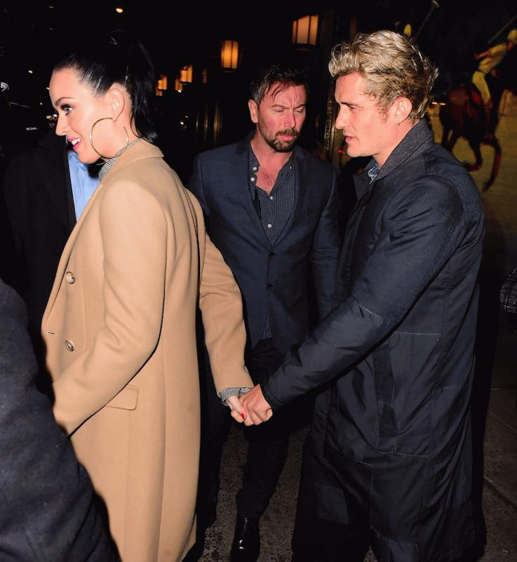 Katy Perry and Orlando Bloom photographed while they were at The Polo Bar in NYC.