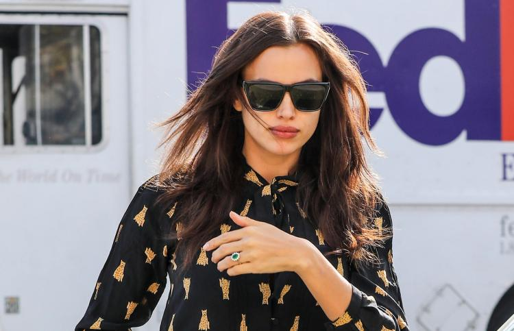Irina Shayk seen wearing a ring on her left ring finger sparking rumors that she and Bradley Cooper are engaged.
