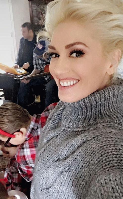 A photo showing Gwen Stefani with her kids, Blake Shelton, and her family spending Christmas together.