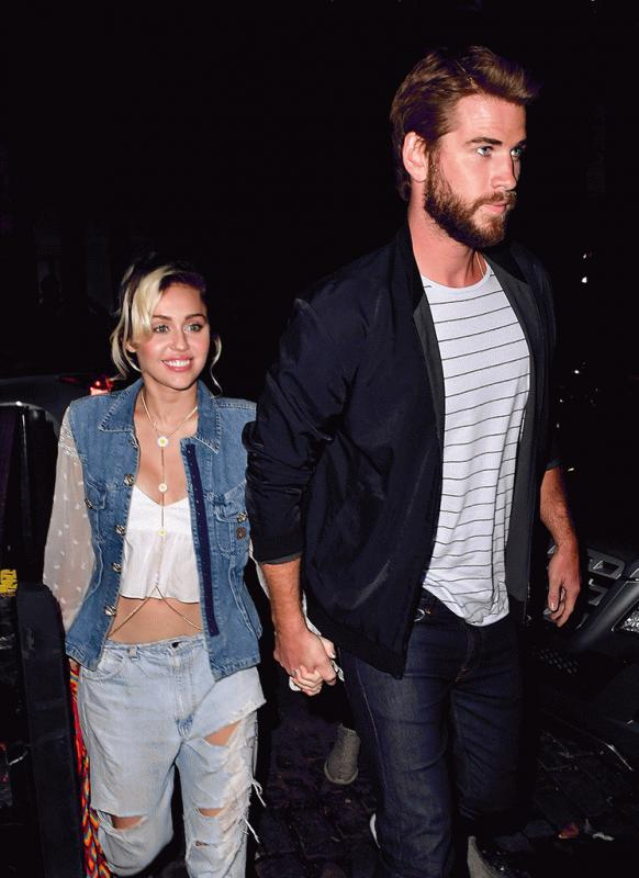 Miley Cyrus and Liam Hemsworth photographed together earlier this year.
