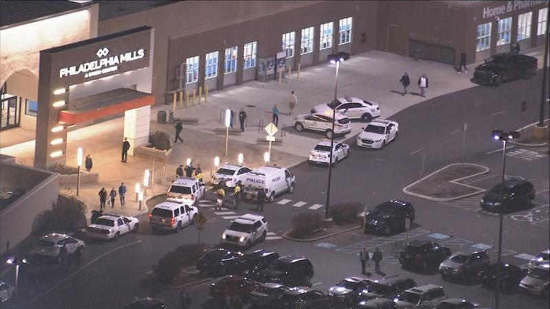 An aerial shot showing authorities outside the Philadelphia Mills mall.