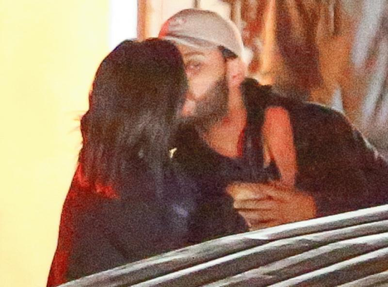 The Weeknd and Selena Gomez photographed locking lips after a date night in Los Angeles.