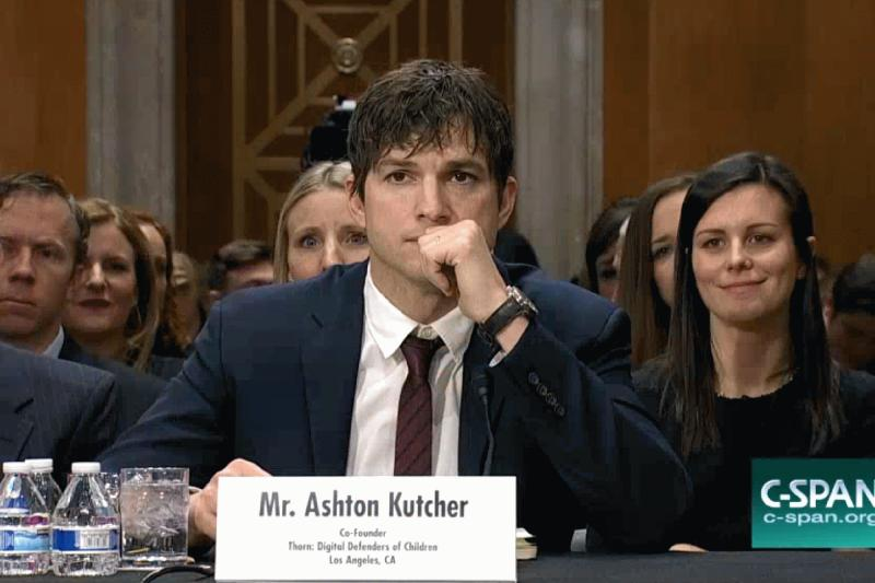 Ashton Kutcher photographed during his speech before the Senate Foreign Relations Committee.