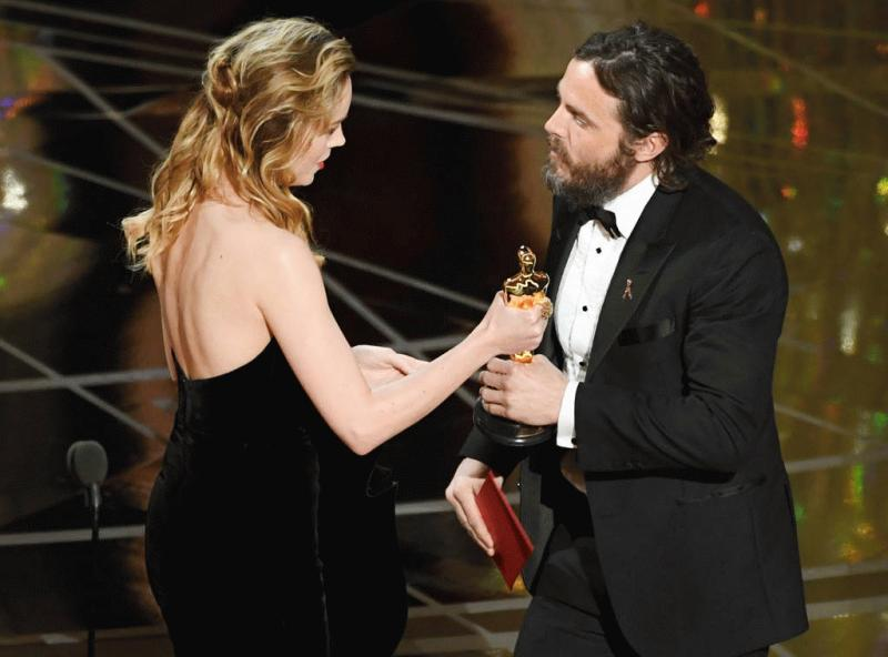 Brie Larson handing Casey Affleck his Oscar award for Best Actor this year.