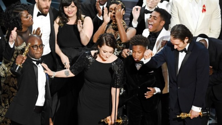 """A photo showing the cast of """"Moonlight"""" celebrating their Best Picture win after mix-up with """"La La Land."""""""