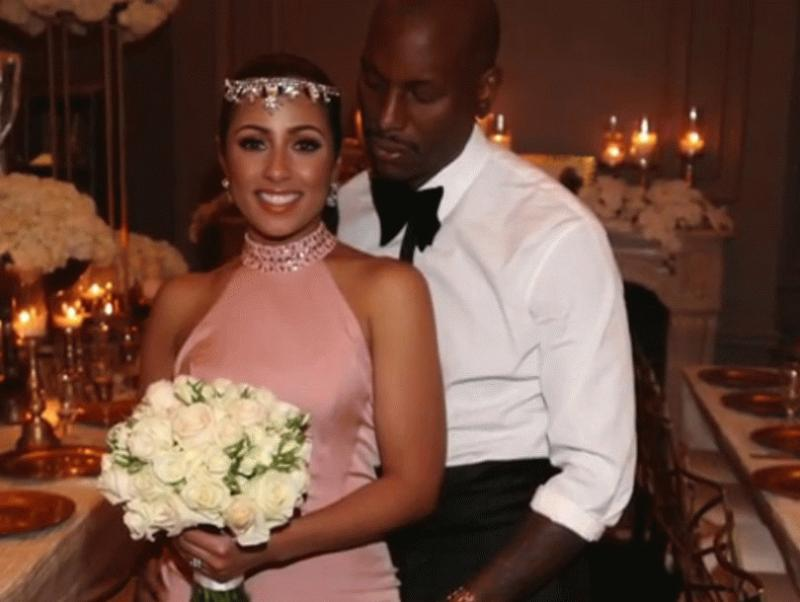 Tyrese Gibson and his unidentified wife in a photo showing their Valentine's Day wedding.